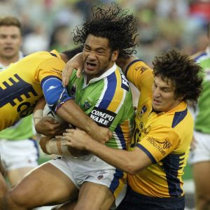 Ruben Wiki going about his business, despite the attention of Nathan Hindmarsh, for the Canberra Raiders in 2004. Photo: Mark Nolan/Getty Images