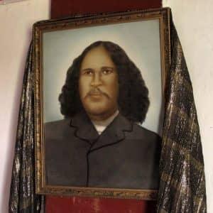 Rua Kenana portrait inside wharenui at Maungapōhatu. (Kennedy Warne)