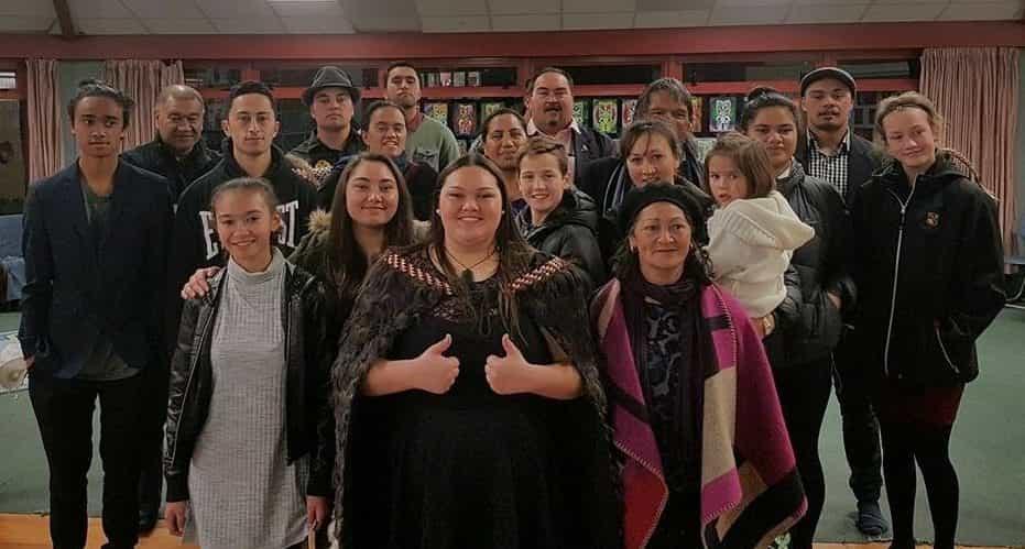 Rawiri's youngest daughter, Te Ngawari (centre front), after her graduation from Te Kura Kaupapa Māori o Ruamata, Rotorua, with the whānau whānui in tow.