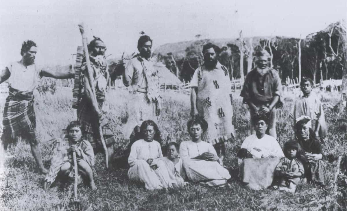 Moriori karāpuna (ancestors) at Manukau, Rēkohu (Chatham Island), in 1884. Back row, fourth from left, is Rangitapua Horomona Rehe, Maui Solomon's great-grandfather. Sitting in front on his right is his wife Ihimaeara. The man holding the staff is Hirawanu Tapu, the Moriori leader and author of the 131-page petition to Governor George Grey in 1862.
