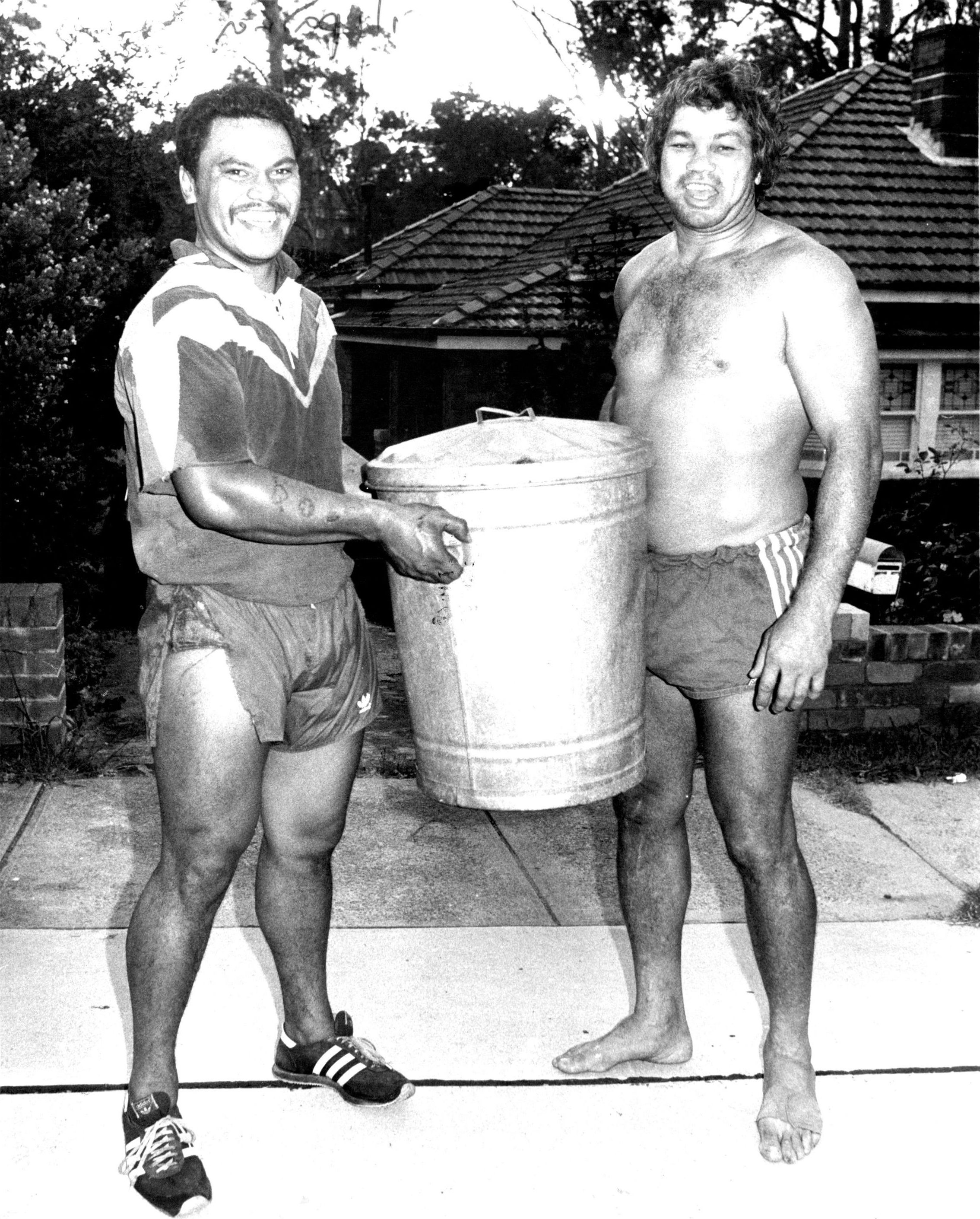 "New rugby league player from New Zealand,Olsen Filipaina, who will play with Balmain, was pictured early this morning on a garbage run in the Ryde area. He is pictured handing over the garbage bin to one of the people on his run...... Parramatta star and""Sun"" columnist Artie Beetson. January 31, 1980. (Photo by Russell McPhedran/Fairfax Media via Getty Images)."