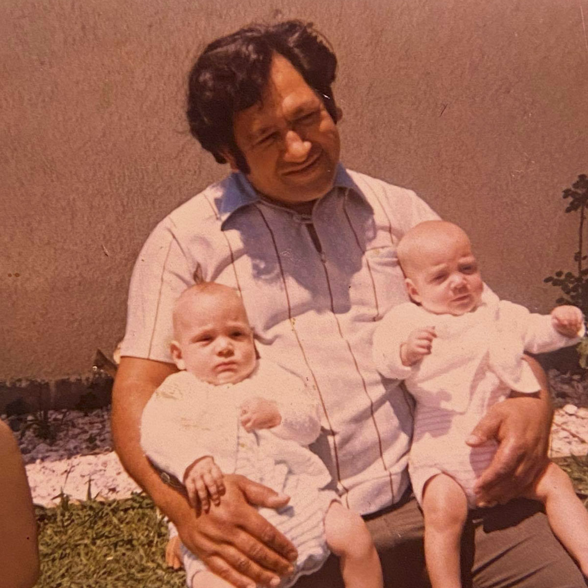 Reginald Borell with his twins Nigel (left) and Belinda (right) aged 18months. Otāhuhu 1974.