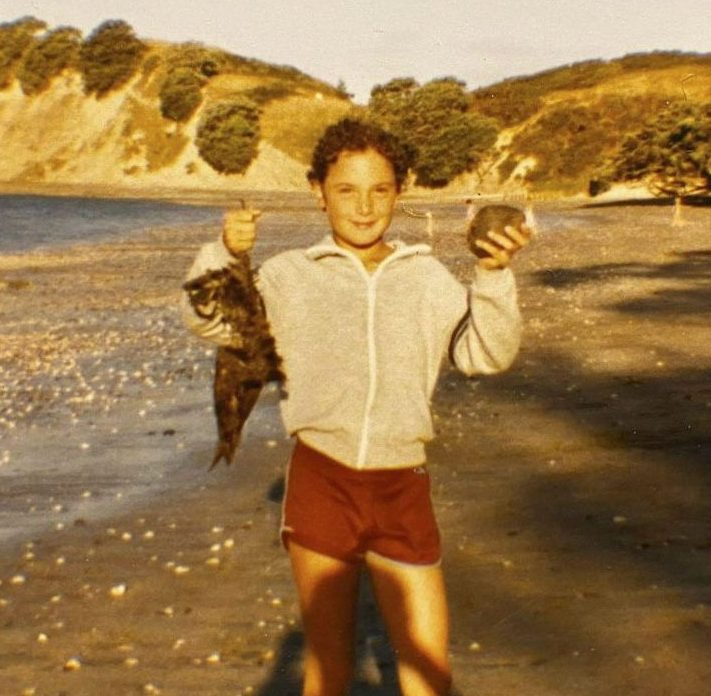 Young Nigel, at Shakespeare Beach, Auckland 1985. Staging a photo with a dead bird and rock on the beach. Photography Sonia Hibbs